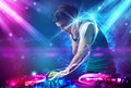 Energetic dj mixing music with powerful light effects young Stock Photo