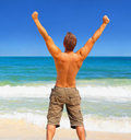 An energetic and satisfied man on the beach Stock Photo