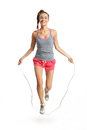 Energetic woman jumping rope happy exercising with a jump Stock Images