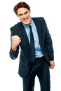 Energetic young businessman excited clenching fist Royalty Free Stock Photography