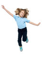 Energetic young child jumping high Royalty Free Stock Photo