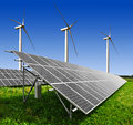 Energy concept solar panels and wind turbine Stock Photography
