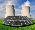 Energy concepts solar panels before a nuclear power plant Royalty Free Stock Images