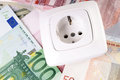 Energy costs socket and many euro banknotes Royalty Free Stock Photo