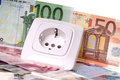 Energy costs socket and many euro banknotes Royalty Free Stock Images