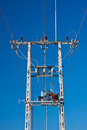 Energy electricity pylon a tower with power lines and transformer isolated on blue sky Royalty Free Stock Photo