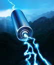 Energy power battery blue sparks on mountain silhouette background Stock Images