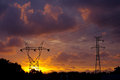 Energy power pylons over a fantastic sunset sky Royalty Free Stock Photography