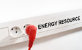 Energy resource imaged by a red plug and an electrical outlet Stock Image