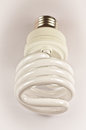 Energy saving light bulb on a white background Stock Photos