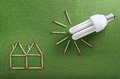 Energy saving setup made out of matchsticks Stock Photos