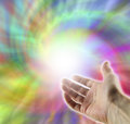 Energy vortex healer open hand reaching up into multicolored Stock Photography