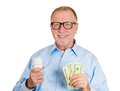 Energy watt savings closeup portrait senior mature business man in nerd black glasses with fluorescent light bulb in one hand and Royalty Free Stock Photos