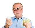 Energy watt savings closeup portrait senior mature business man in nerd black glasses with fluorescent light bulb in one hand and Stock Image