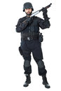 Enforcing the law a swat agent wearing a bulletproof vest and aiming with a gun Royalty Free Stock Photography