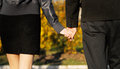 Engaged couple holding hands just outdoors Stock Photos