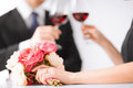 Engaged couple with wine glasses picture of in restaurant Royalty Free Stock Images