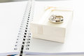 Engagement ring and gift box on note book white Stock Photos