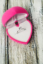 Engagement ring in a pink gift box in heart shape close up Royalty Free Stock Photo