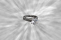 Engagement ring an or wedding in the middle of a sun rays Royalty Free Stock Images