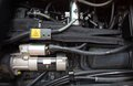 Engine black with hose and mechanical part Royalty Free Stock Photo