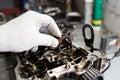 Engine crankshaft, valve cover, pistons. mechanic repairman at automobile car engine maintenance repair work Royalty Free Stock Photo