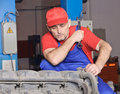 Engine mechanic looking for problems Stock Photos