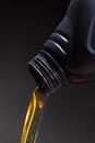 Engine oil beeing poured being close up Royalty Free Stock Photos