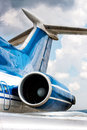 Engine and tail detail of business jet airplane Royalty Free Stock Photo