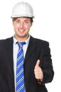 Engineer or architect in suit successful thumbs up showing male business man wearing white hard hat signalling success hand sign Stock Image