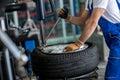 Engineer balancing car wheel on balancer Royalty Free Stock Photo