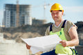 Engineer builder at construction site with draft one blueprint plan Stock Images
