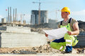 Engineer builders at construction site with draft Stock Image