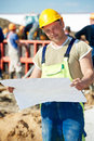 Engineer builders at construction site with draft one builder blueprint plan Royalty Free Stock Image