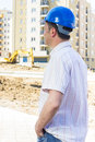Engineer on construction site with blue hard hat the Stock Images