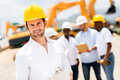 Engineer at a construction site handsome male looking happy Stock Photos