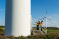 Engineer and geologist consult close to wind turbines in the countryside Royalty Free Stock Photo