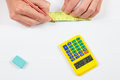 Engineer hands at work with a pencil, digital calculator and ruler Royalty Free Stock Photo