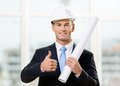 Engineer in hard hat hands layout and thumbs up Royalty Free Stock Photography