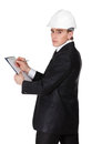 Engineer in hard hat makes notes white isolated on white Stock Photos