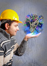 Engineer with a helmet on his head looking building project that grows hand Stock Photos