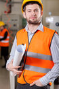 Engineer holding project, vertical Stock Image