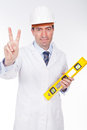 Engineer with level and positive expression Stock Image