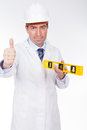 Engineer with level with positive expression an Stock Photos