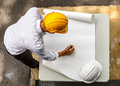 Engineer looking paper plans at construction site, Top view Royalty Free Stock Photo