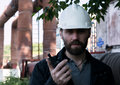 Engineer man supervisor holding blueprints plan and inspects the pipeline Royalty Free Stock Photo