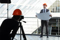 Engineer photographer shoots architect in the office center Stock Photo