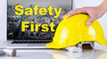 Engineer is picking up safety helmet for Safety First Royalty Free Stock Photo