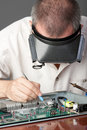 Engineer repairing circuit board Stock Images