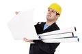 Engineer with rolls of paper in hand studies Royalty Free Stock Photo
